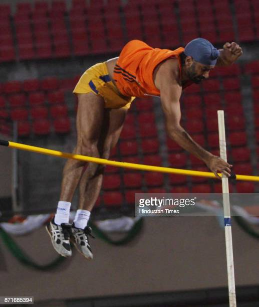 A particiapnat competing at the bar jump atheletic event in the Birsa Munda Main Athletic Stadium at Hotwar in the 34 th National Game in Ranchi