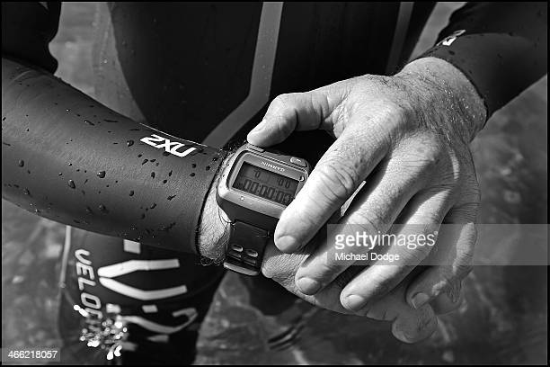 A participant activates his watch for a training swim ahead of the Melbourne Challenge Series event on February 1 2014 in Melbourne Australia...