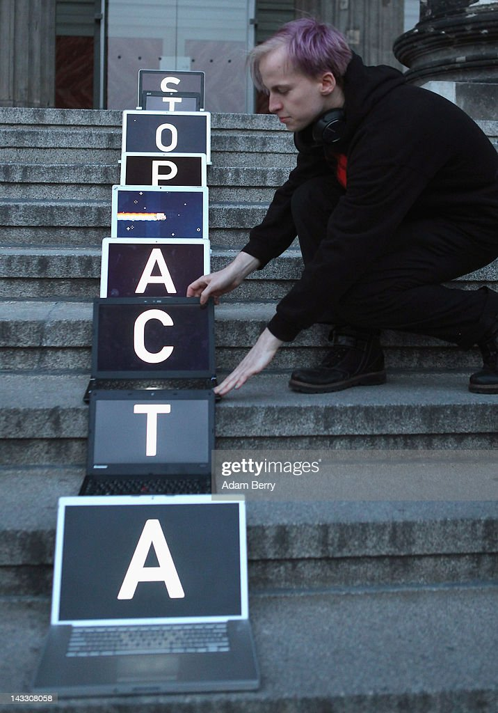 A participant arranges laptop computers featuring screens with letters spelling out the words 'Stop ACTA' during a demonstration against Internet copyright restrictions resulting from the Anti-Counterfeiting Trade Agreement (ACTA) in front of the Altes Museum (Old Museum) on April 23, 2012 in Berlin, Germany. ACTA is a proposed treaty attempting to establish an international governing body with legal standards intended to protect intellectual property and prevent the production and sale of counterfeit goods. The German government has delayed a decision on the agreement, citing concerns by the Justice Ministry, and according to news reports is waiting for approval by the European Parliament prior to signing the multinational treaty.
