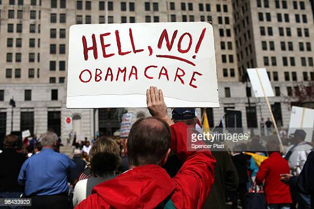 A participant at a Tea Party Express rally displays a sign critical of the Obama administration on April 13 2010 in Albany New York The Tea Party...