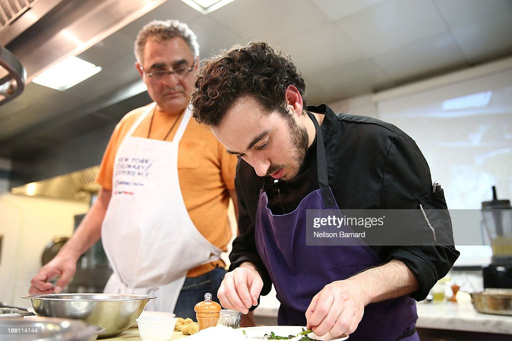 A participant attends 'Spring Restaurant Favorites' taught by Daniel Rose (R) of Spring in Paris on day 2 of the New York Culinary Experience 2013 on May 5, 2013 in New York City.