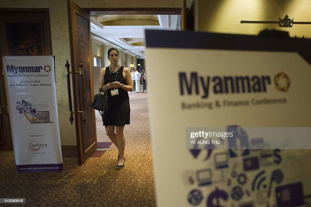 A participant attends the Myanmar Banking and Finance Conference in Yangon on June 28, 2016. More than 250 banking and finance profeesionals from over 10 countries are attending the two-day conference. / AFP / YE