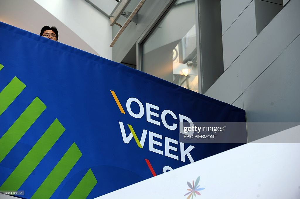 A participant attends the OECD Week at the OECD headquarters on May 6 2014 in Paris The OECD presented its Economic Outlook on Tuesday AFP PHOTO ERIC...