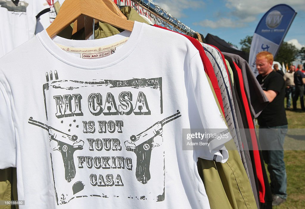 A participant browses a rack of t-shirts for sale including one reading 'Mi Casa Is Not Your Fucking Casa,' for sale at the German far-right Nationaldemokratische Partei Deutschlands - Die Volksunion (National Democratic Party, NPD) 'Pressefest' summer festival, organized by the party's publication, the 'Deutsche Stimme' (the German Voice), on August 11, 2012 in Pasewalk, Germany. The event took place in the German state of Mecklenburg-Vorpommern, known as a stronghold for the NPD, where the party won over 30% of the votes in two districts in state elections in 2011. There have been two attempts to legally ban the right-wing group, in 2003 and 2011, after a neo-Nazi terrorist cell murdered at least nine people of predominently Turkish background as well as one policewoman between 2000 and 2007.