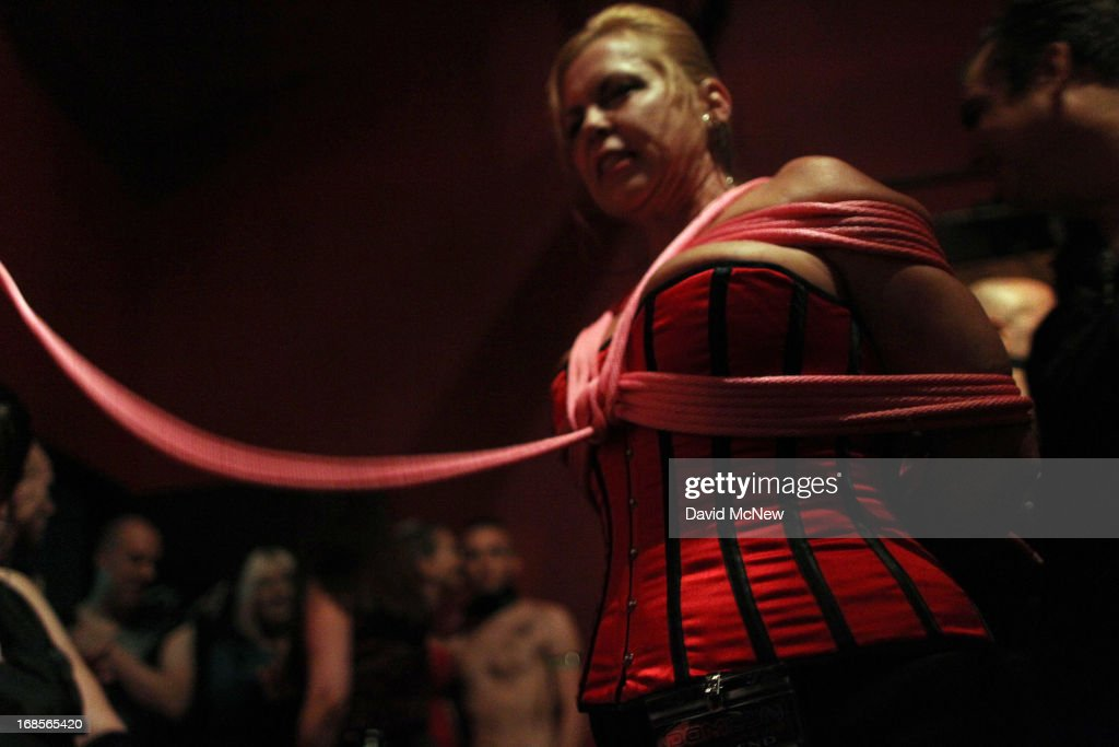 A participant called SgChill is bound in rope at a dungeon party during the domination convention, DomConLA, in the early morning hours of May 11, 2013 in Los Angeles, California. The annual convention was started in 2003 by fetish professional Mistress Cyan to bring together enthusiasts of BDSM (Bondage, Discipline, Dominance/Submission, and Sadomasochism) and other fetishes.