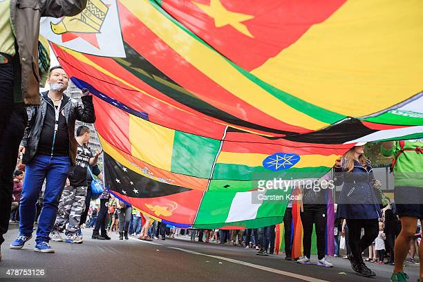 Participant carry several flags a Christopher Street Day parade on June 27 2015 in Berlin Germany Similar marches are taking place in various cities...