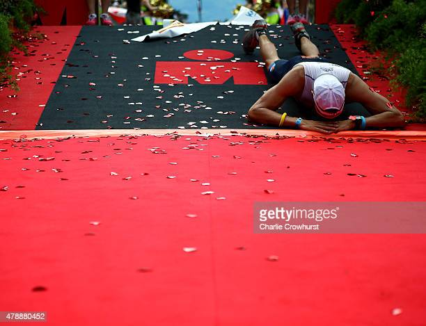 A participant collapses after crossing the line during Ironman Klagenfurt on June 28 2015 in Klagenfurt Austria