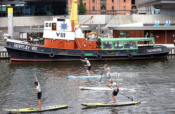 Participant competes during the Stand Up Paddling celebrity race at Magellan Terassen on August 16 2013 in Hamburg Germany