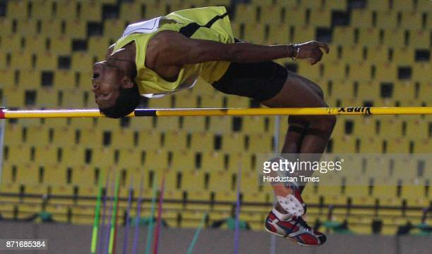 A participant competing at the High Jump athletics event in the Birsa Munda Main Athletic Stadium at Hotwar in the 34 th National Game in Ranchi