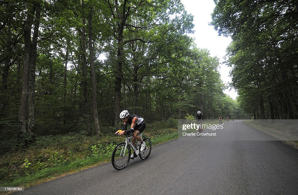 A participant cycles through the woods during the Challenge Triathlon Vichy on September 01, 2013 in Vichy, France.