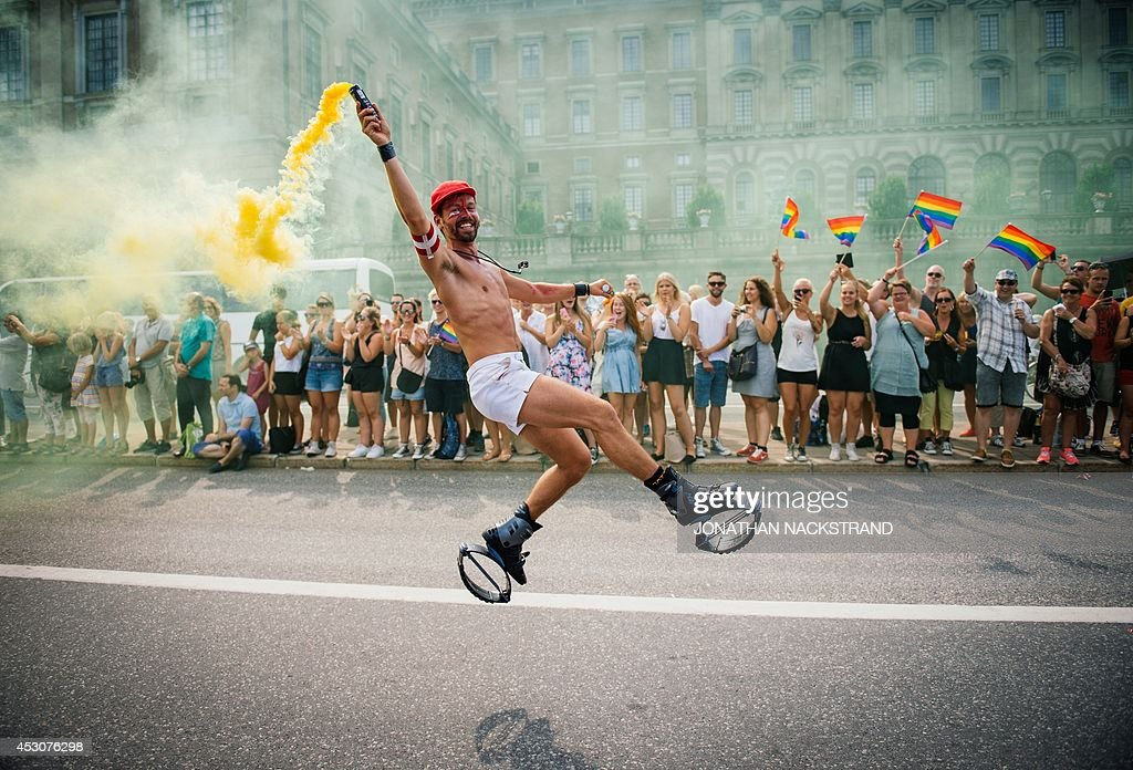 A participant dances during the Gay Pride Parade on August 2, 2014, in Stockholm.