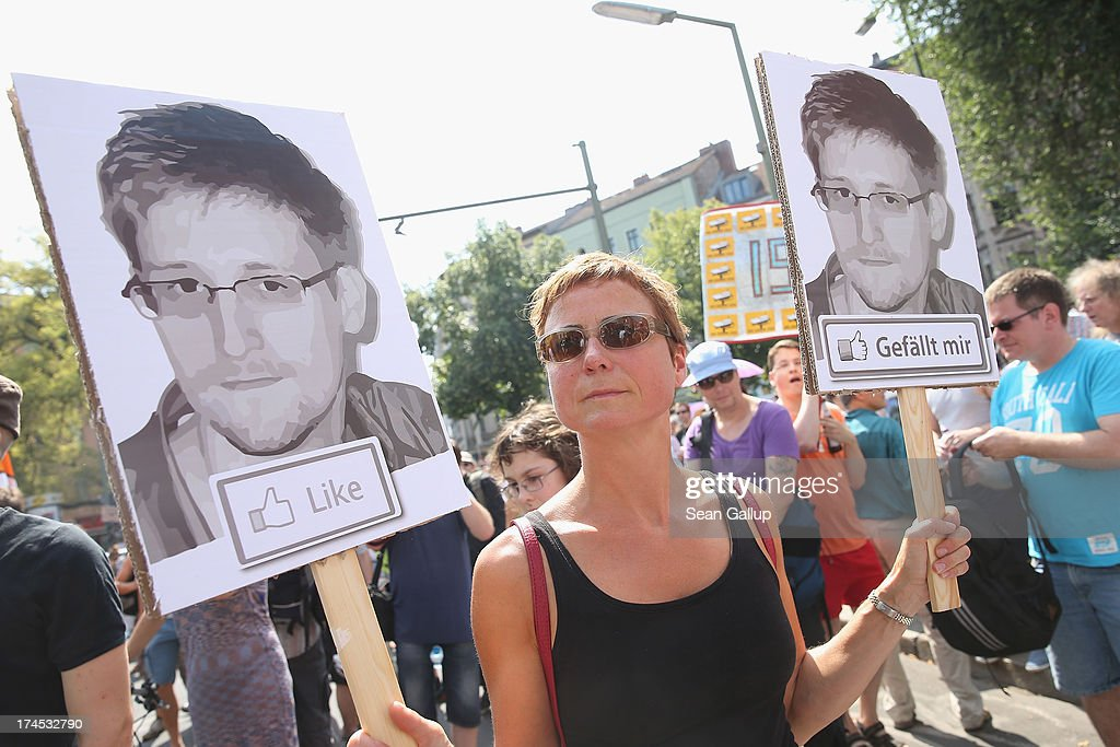 A participant demonstrates in support of former NSA employee <a gi-track='captionPersonalityLinkClicked' href=/galleries/search?phrase=Edward+Snowden&family=editorial&specificpeople=10983676 ng-click='$event.stopPropagation()'>Edward Snowden</a> at a protest march against the electonic surveillance tactics of the NSA on July 27, 2013 in Berlin, Germany. The NSA scandal has been especially contentious in Germany after media reports claimed the NSA had conducted wide scale gathering of electonic data, including e-mails, of German citizens. Activists are demonstrating against the NSA in cities across Germany today.