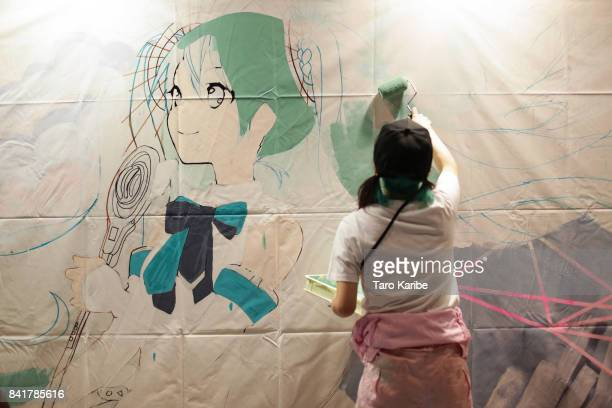 A participant draws a painting of Hatsune Miku on September 1 2017 in Chiba Japan Hatsune Miku singing voice synthesizer developed by music software...