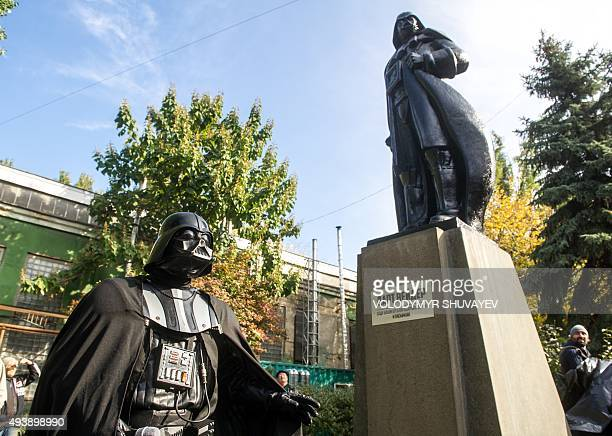 A participant dressed as Darth Vader a character from the 'Star Wars' film takes part in an inauguration ceremony of a Darth Vader monument formerly...