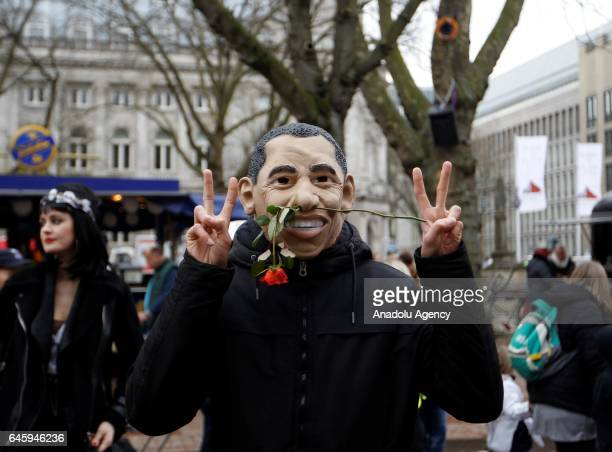 A participant dressed as former US President Barack Obama is seen during the traditional Rose Monday carnival parade in Duesseldorf Germany on...