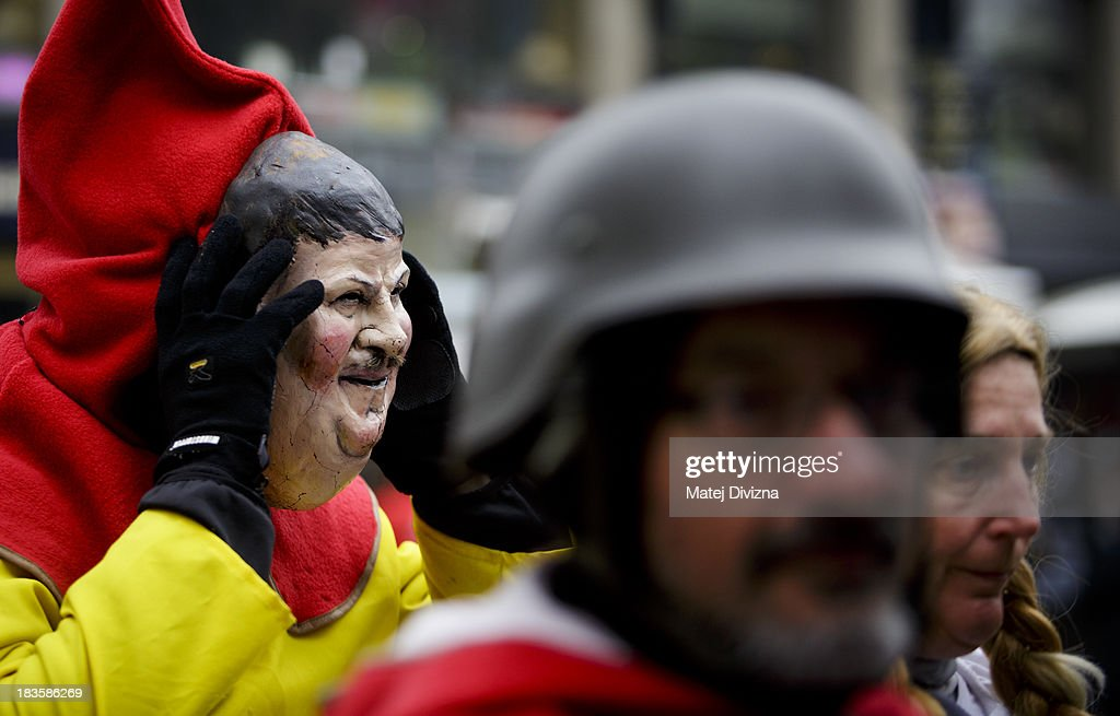 A participant dressed as German politician Bernd Posselt attends the 'Klassenkampf statt Weltkrieg' (Class Struggle Instead of World War), a campaign supported by Deutsche Kommunistische Partei (DKP), at the Wenceslas square on October 7, 2013 in Prague, Czech Republic. The meeting took place to mark the 75th Anniversary of The Munich Pact.