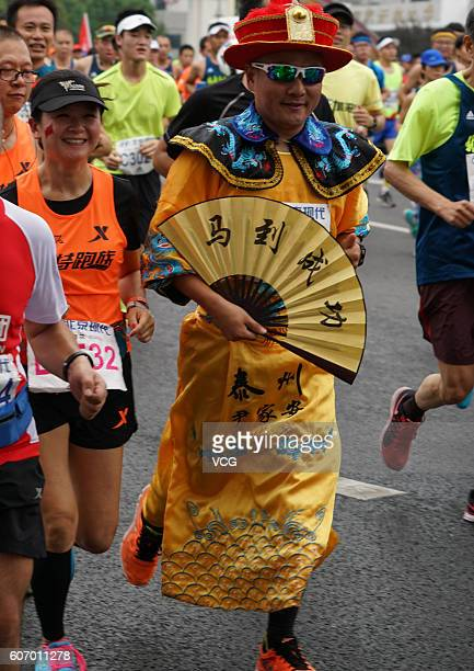 A participant dressed himself runs on road during the 2016 Beijing Marathon on September 17 2016 in Beijing China Running from the Tian'anmen Square...
