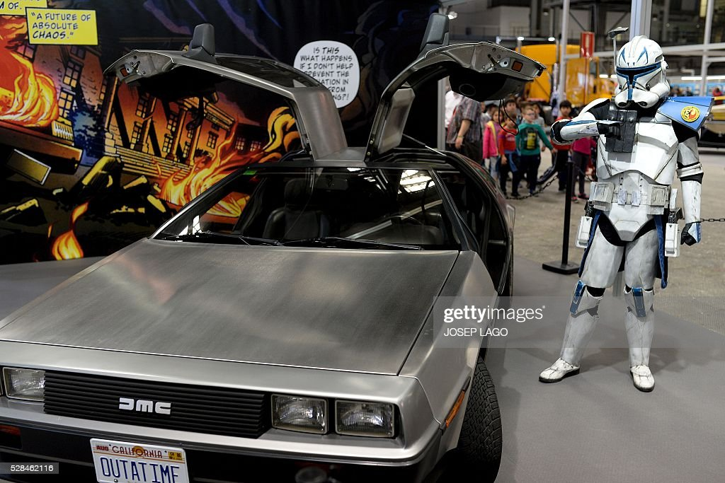 A participant dressed up as a Star Wars saga character stands next to a 'DeLorean DMC-12', the car of the film 'Back to the Future' during the 34th Comic Fair 2016 in Barcelona on May 5, 2016. LAGO