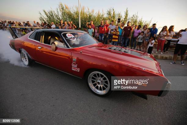A participant drives a Dodge 400 Magnum during the Collection Cars Parade event in the Lebanese coastal city of Amchit on August 27 2017 / AFP PHOTO...