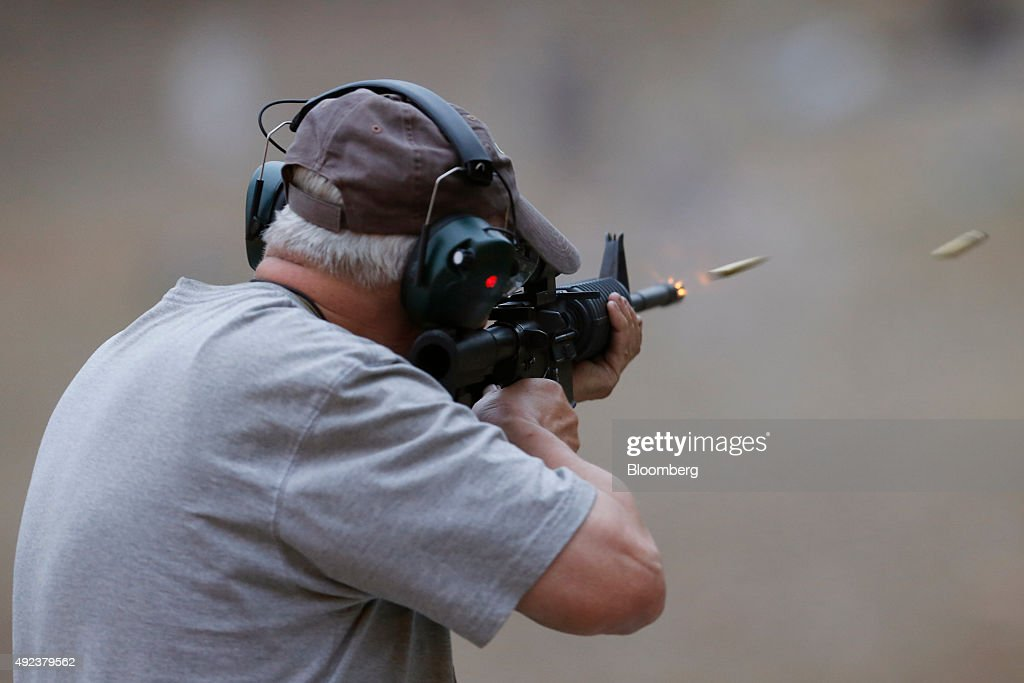 A participant fires an M4 carbine during the Fall 2015 Knob Creek Machine Gun Shoot in West Point Kentucky US on Friday Oct 9 2015 The Machine Gun...