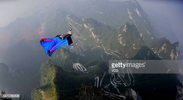 Participant flies on the sky with wingsuit during the 6day Wingsuit Flying World Championship sponsored by Red Bull on October 14 2014 in Zhangjiajie...