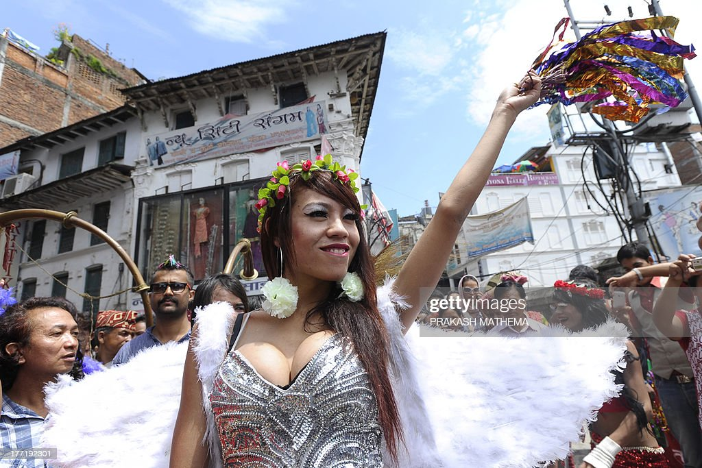 A participant gestures during Nepal's 4th International Gay Pride parade in Kathmandu on August 22, 2013. Scores of gays, lesbians, transvestites and transsexuals from across the country took part in the rally to spread their campaign for sexual rights in the country. AFP PHOTO/Prakash MATHEMA