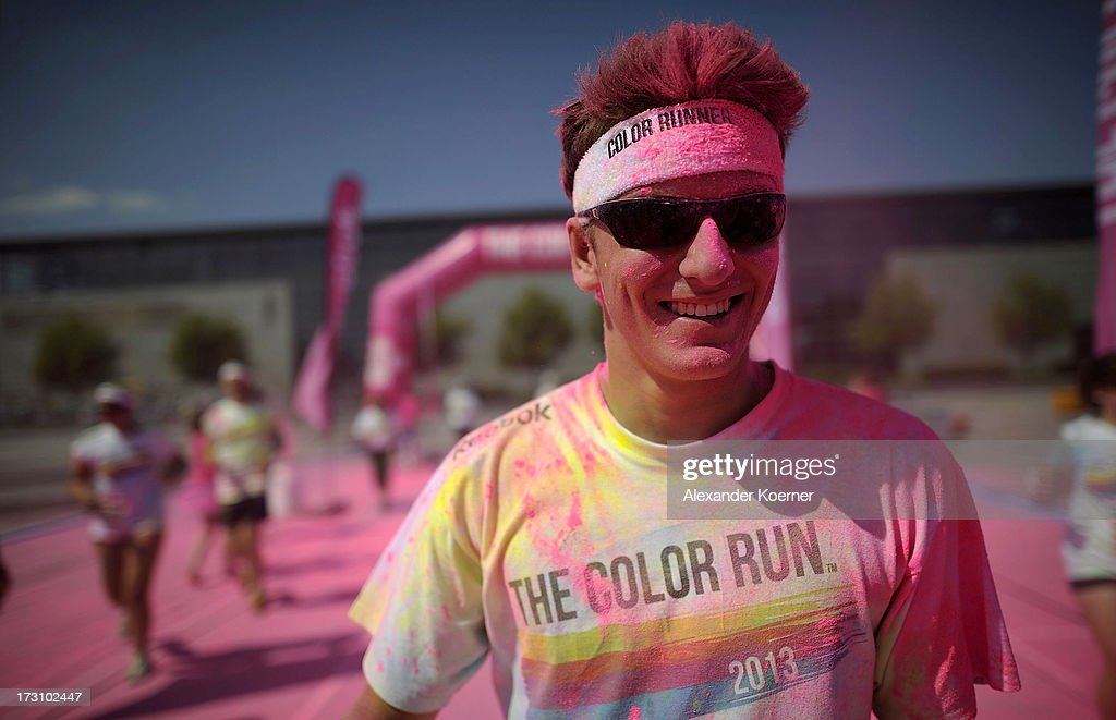 A participant has pink powder thrown at him as he runs through the pink colour zone during the Color Run at the Hanover Fairgrounds on July 7, 2013 in Hanover, Germany. The Color Run is a 5km run during which participants, who dress in white, have a different colored cornflour based powder thrown at them for every kilometer that they run. This was the second Color Run to be held in Germany, attacting 5000 runners.