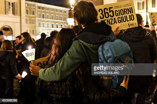 A participant holds a placard with the lettering '365 days without Giulio' as activists of human rights organization Amnesty International take part...