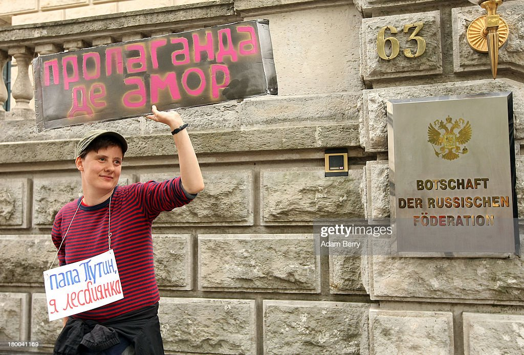 A participant holds a sign reading 'Propaganda De Amor - Papa Putin, I'm a Lesbian' in Russian while demonstrating in front of the Russian Embassy during the 'To Russia With Love' Global Kiss-In on September 8, 2013 in Berlin, Germany. The event was designed to show international solidarity with homosexuals in Russia, currently under pressure from with what is considered by some in societies with more liberal gay rights policies to be homophobic legislation.