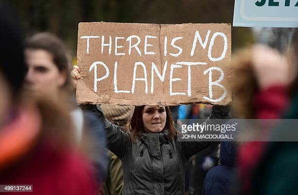 A participant holds a sign reading 'There is no Planet B' during the 'Global Climate March' organised by environmental NGOs on November 29 2015 in...
