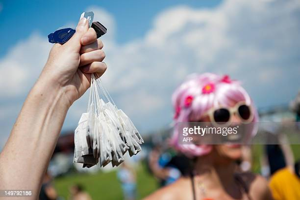 A participant holds up teabags at the Slowolympics in Berlin Germany on August 04 2012 The participants will throw sausages and tea bags at this fun...