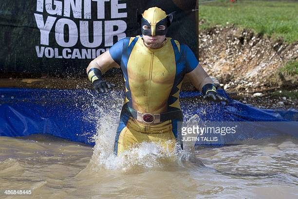 A participant in a costume jumps from a four meter high platform into water during the Tough Mudder endurance race in Henley on Thames West of London...