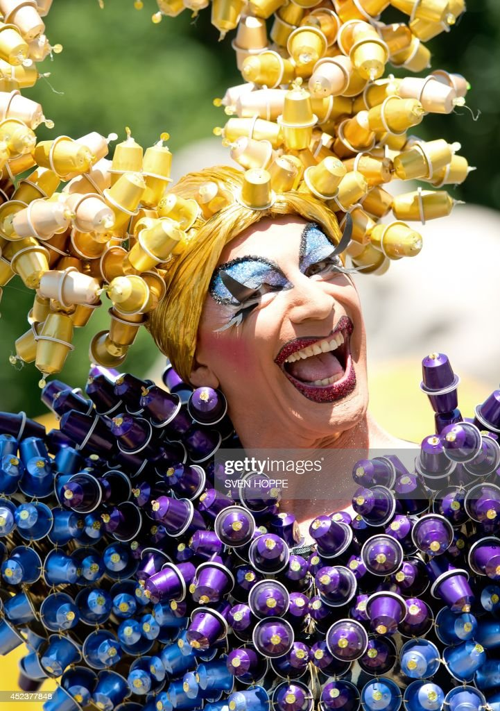 A participant in a fancy dress attends the Christopher Street Day (CSD) street parade of gays and lesbians on July 19, 2014 in Munich, southern Germany. This year's parade was titled 'Rainbow of the Genders - We're all valuable'. AFP PHOTO / DPA / SVEN HOPPE / GERMANY OUT