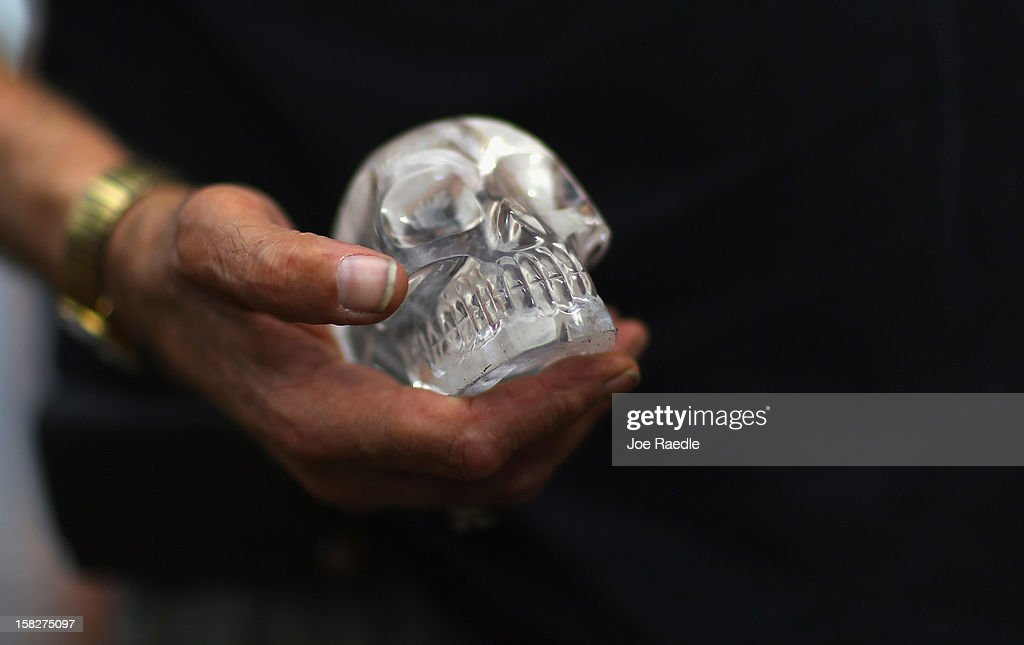 A participant in a sacred 12.12.12 ceremony holds a crystal skull at Miami Circle which is a Tequesta indian site used centuries ago on December 12, 2012 in Miami, United States. The ceremony was held on the calender date of 12-12-12 which is the last major numerical date using the Gregorian or Christian calendar for almost another century.
