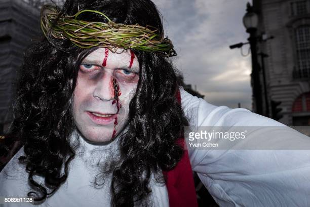 A participant in a zombie parade dressed as Jesus About a 100 zombies descended on central London to mark world Zombie day They swarmed around...