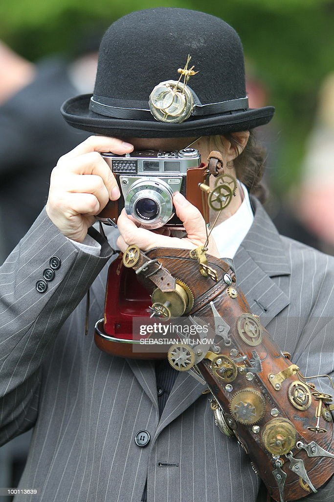 A participant in an annual Wave-Gothic festival takes a photo on May 21, 2010 in Leipzig, eastern Germany, where more than 20 000 people are expected to attend the festival attracting the friends of gothic romanticism. The festival offers a very special spectacle with a range of concerts, historical markets, theatre and cinema, gothic scene performances, exhibitions, readings and parties.