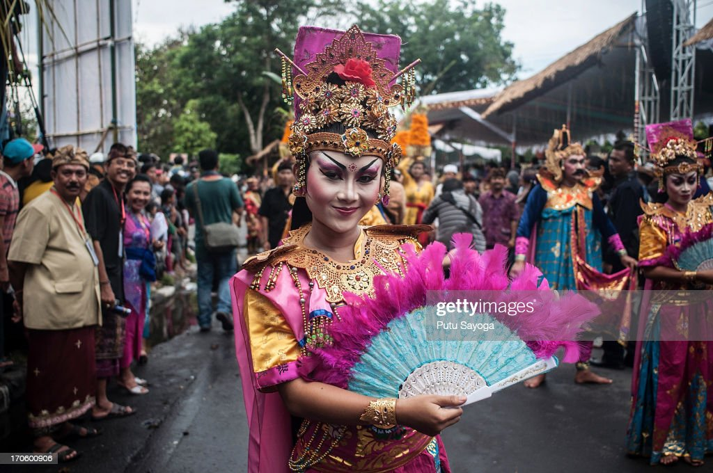 A participant in costume dances during the Bali International Arts Festival on June 15, 2013 in Denpasar, Bali, Indonesia. The annual month-long festival runs from June 15 to July 13, 2013 and features 340 local and international art communities with thousands of performers.