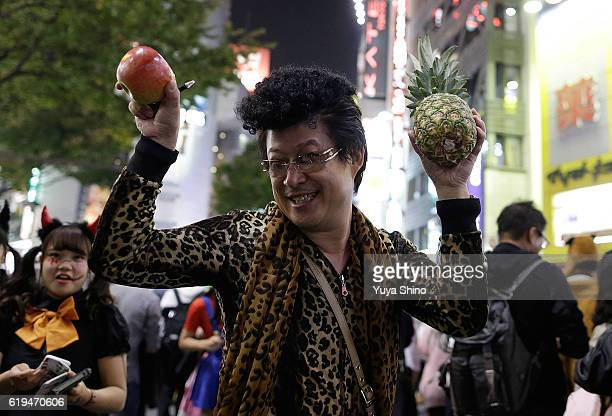 A participant in costume of a Japanese comedian and youtuber Pikotaro known for his song 'PPAP' poses for a photograph during Halloween celebrations...