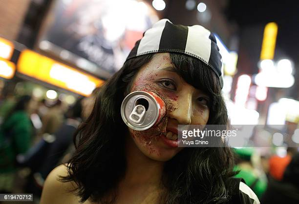 A participant in costume poses for a photograph during Halloween celebration at Shibuya district on October 31 2016 in Tokyo Japan