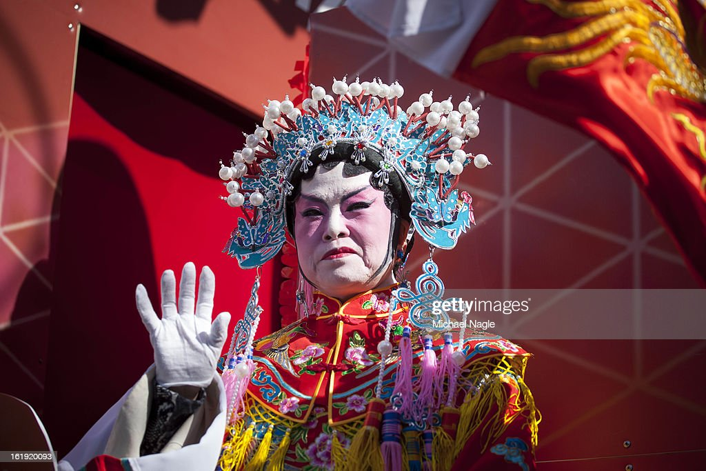 A participant in the 14th Annual Chinatown Lunar New Year Parade waves from a float on February 17, 2013 in New York City. This year celebrates the Year of the Snake.