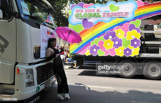 A participant in the 15th annual gay pride parade entitled 'We are family' rests on July 3 2010 in the center of Vienna More than 100000 took part in...