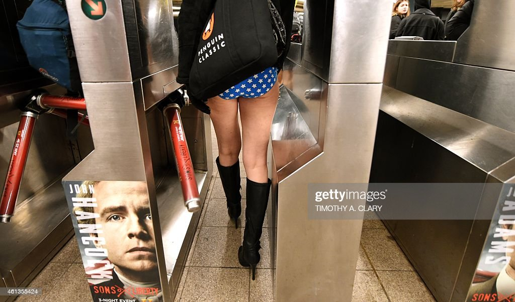 A participant in the No Pants Subway Ride in her underwear enters the New York subway on January 11 2015 in New York The No Pants Subway Ride is an...