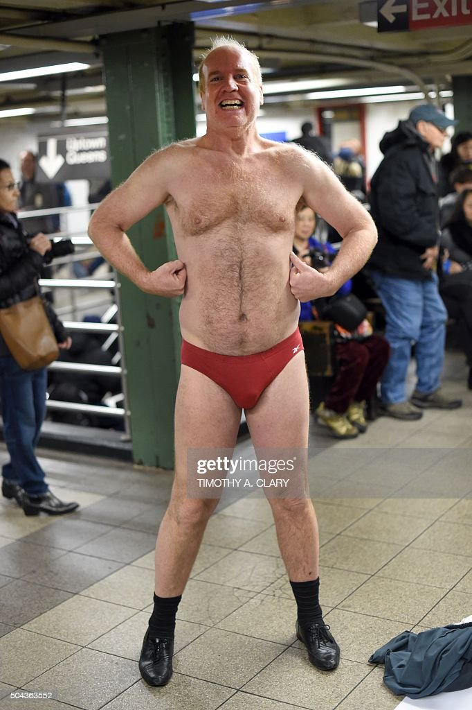 A participant in the 'No Pants Subway Ride' poses on a New York City subway platform January 10 2016 in New York The 'No Pants Subway Ride' is an...