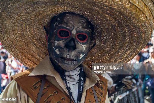 A participant in the parade during the Day of the Dead Celebrations in Mexico City feature a deadly skull