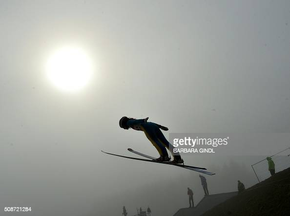 TOPSHOT A participant jumps during the qualifying round of the women's ski jumping world cup in Hinzenbach Upper Austria on February 6 2016 / AFP /...