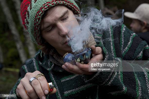 A participant lights up a pipe loaded with marijuana at the Emerauld Cup on December 11 2010 in Area 101 a new age center where the 7th annual...