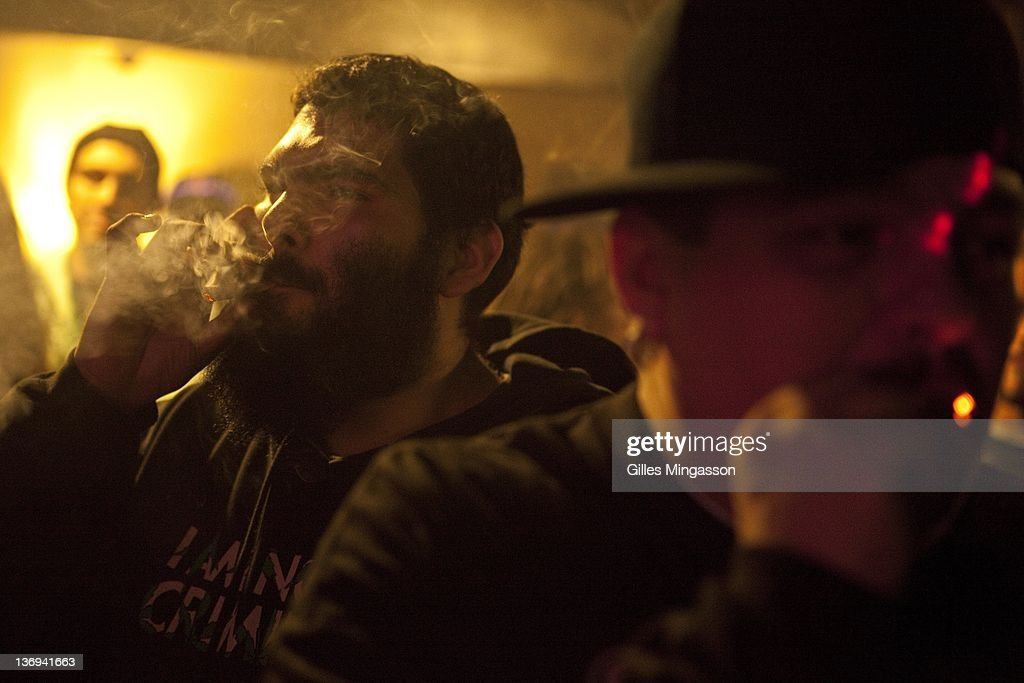 A participant lights up during the award ceremony on December 11, 2010 at the Emerauld Cup in Area 101 (name after nearby Highway 101), a new age center where the 7th annual Emerauld Cup is being held. The Oscars of the marijuana world, the Emerald Cup bestows honors on the best medecinal marijuana grown outside (indoor marijuana is not accepted) in the region known as the Emerald Triangle (Mendocino, Humbold and Trinity County), reputed to be the best in the world. 110 growers presented 136 strands, judged on four criterias: appearance, taste, aroma, and potency. A thousand participants attended the festival. Located about four hours north of San Francisco in deeply fotested areas, and bestowed with perfect growing conditions, the Emerald Triangle has become the marijuana capital of the U.S.. Made legal by the Compassionate Use Act, the Emerald Triangle's medecinal marijuana culture generates over 14 billion dollars annualy, about two third of the counties' revenue (photo Gilles Mingasson/Getty Images).