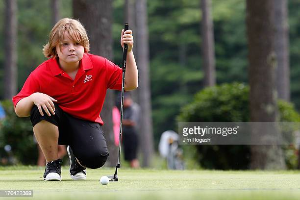A participant lines up a putt during the Drive Chip and Put Regional Championship at Pinehills Golf Club on August 12 2013 in Plymouth Massachusetts...