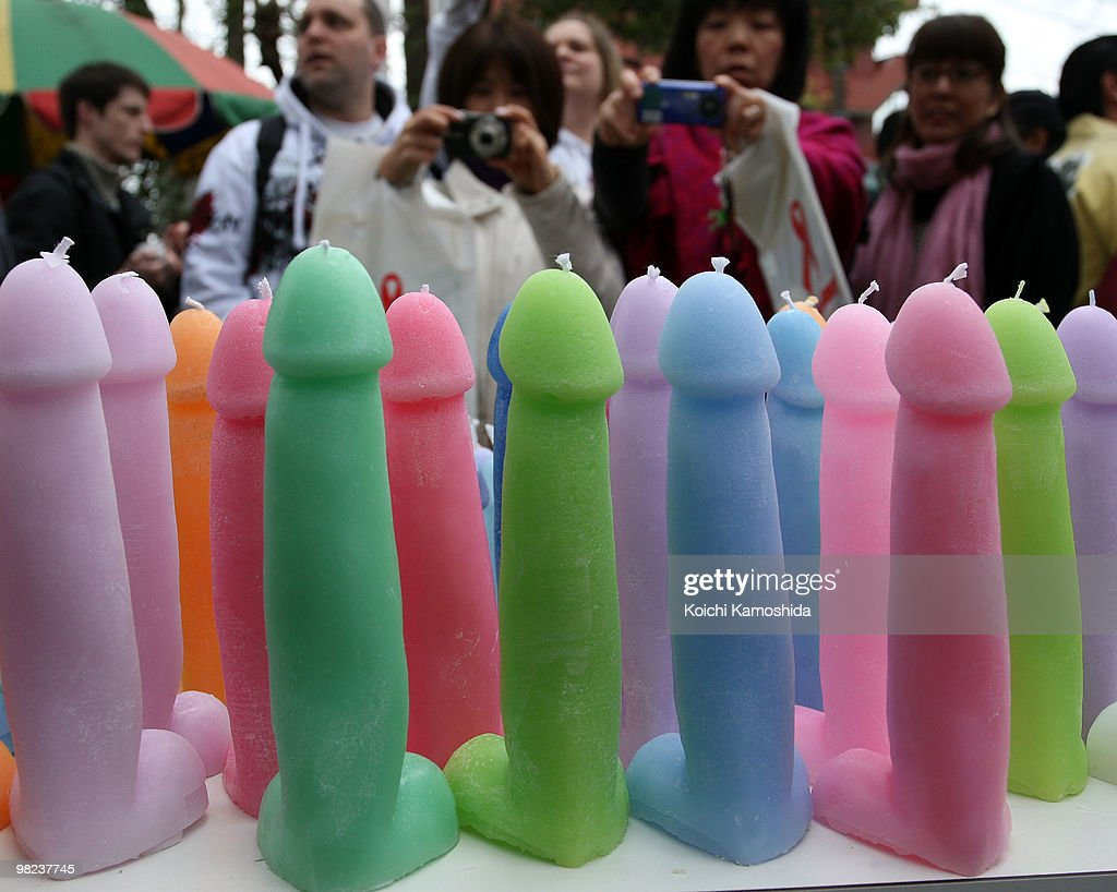 Participant look on a phallusshaped candles during the Kanamara Festival or the Utamaro Festival near Wakamiya Hachimangu Shrine on April 4 2010 in...