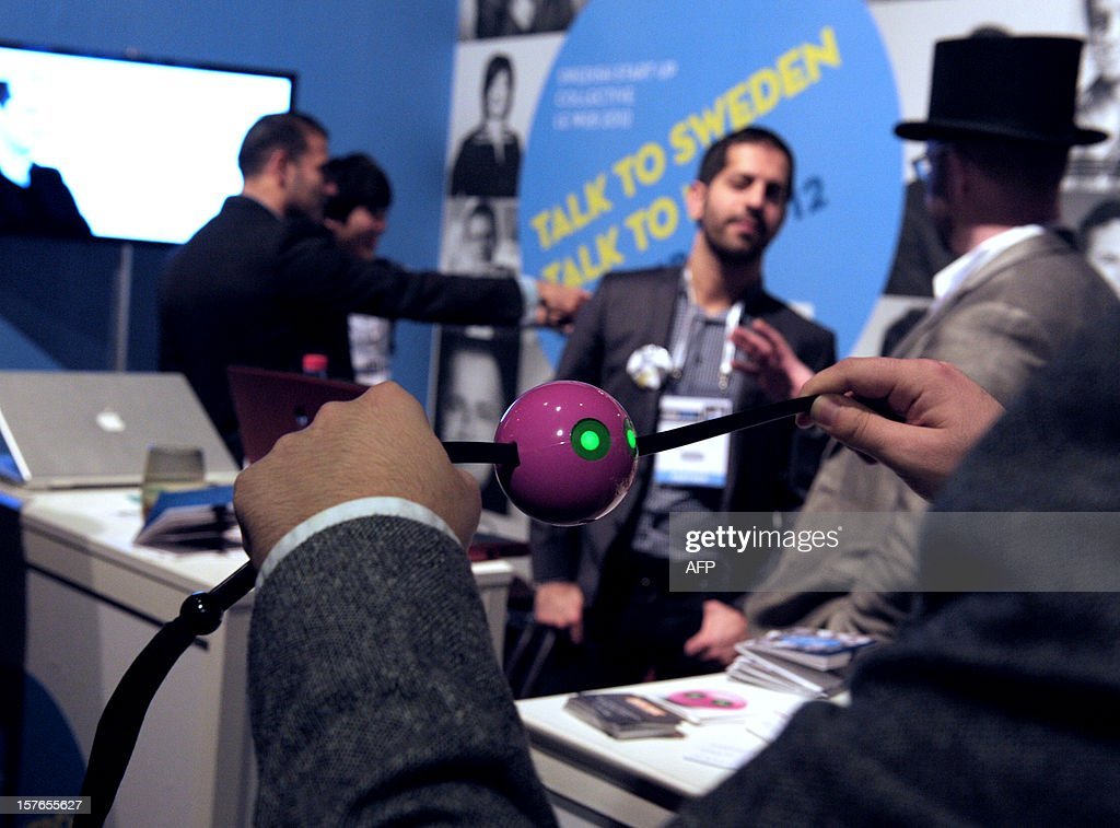 A participant looks at a motion-based and handheld game console called Oriboo on the Swedish start-up stand at LeWeb Paris 2012 in Saint-Denis, near Paris on December 5, 2012. AFP PHOTO ERIC PIERMONT